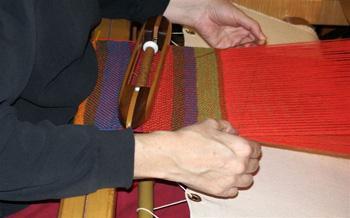 A beginner using a loom