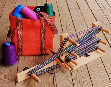 Inkle weaving belts and straps on simple loom in Linda Hartshorn's workshop