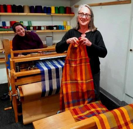Intermediate students weave a project of their choice on a loom