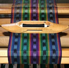Weave colorful ikat by designing with stripes and tie dyeing warp yarn