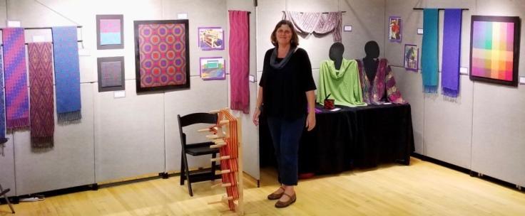 Linda Hartshorn displays her colorful handwoven textiles